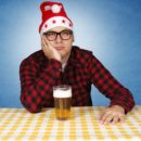 15895736 - bored santa with the beer. selective focus on the man.